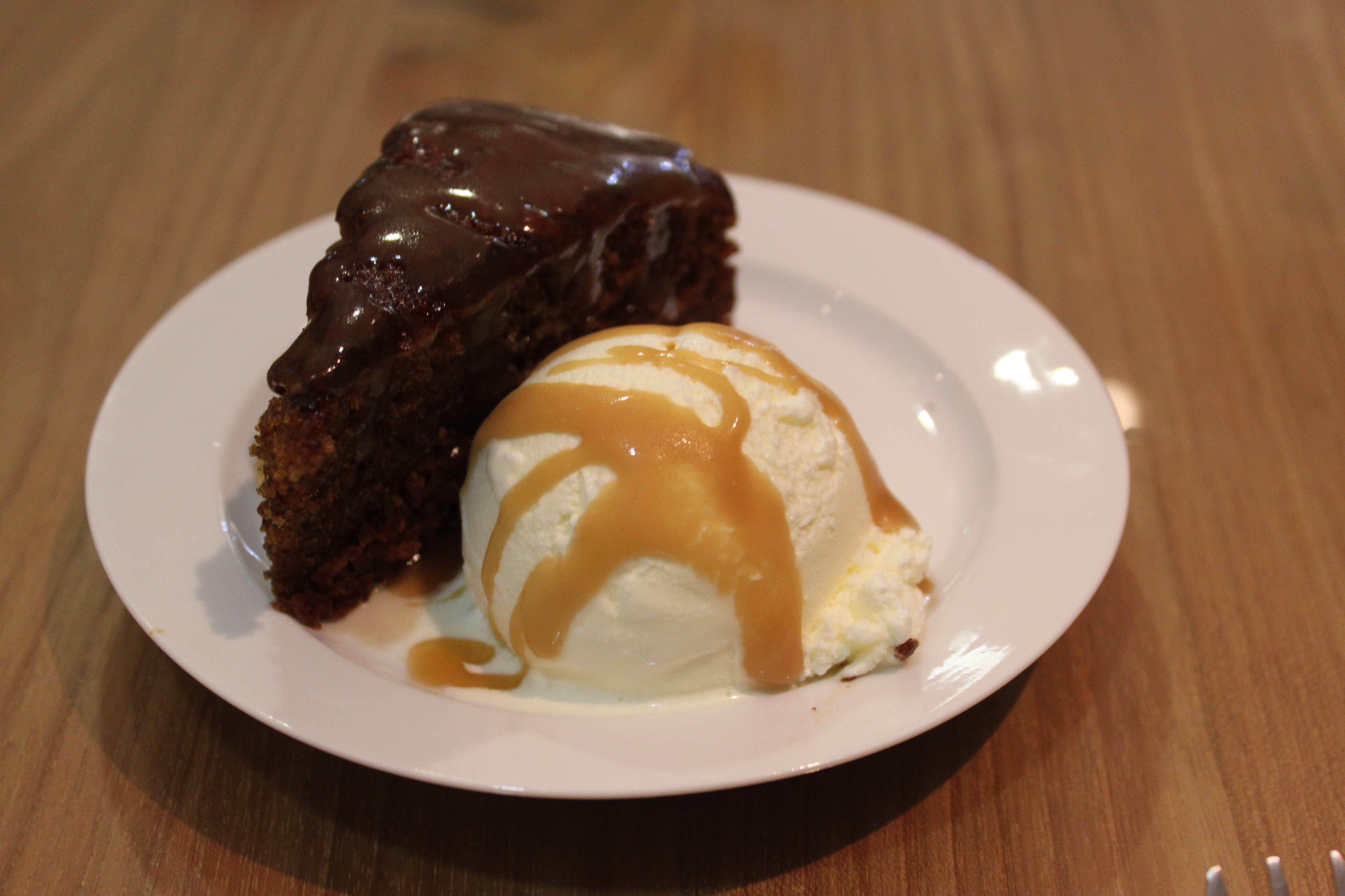 Cafe Valetta: Sticky date pudding with butterscotch sauce, pistachio  praline and vanilla bean ice
