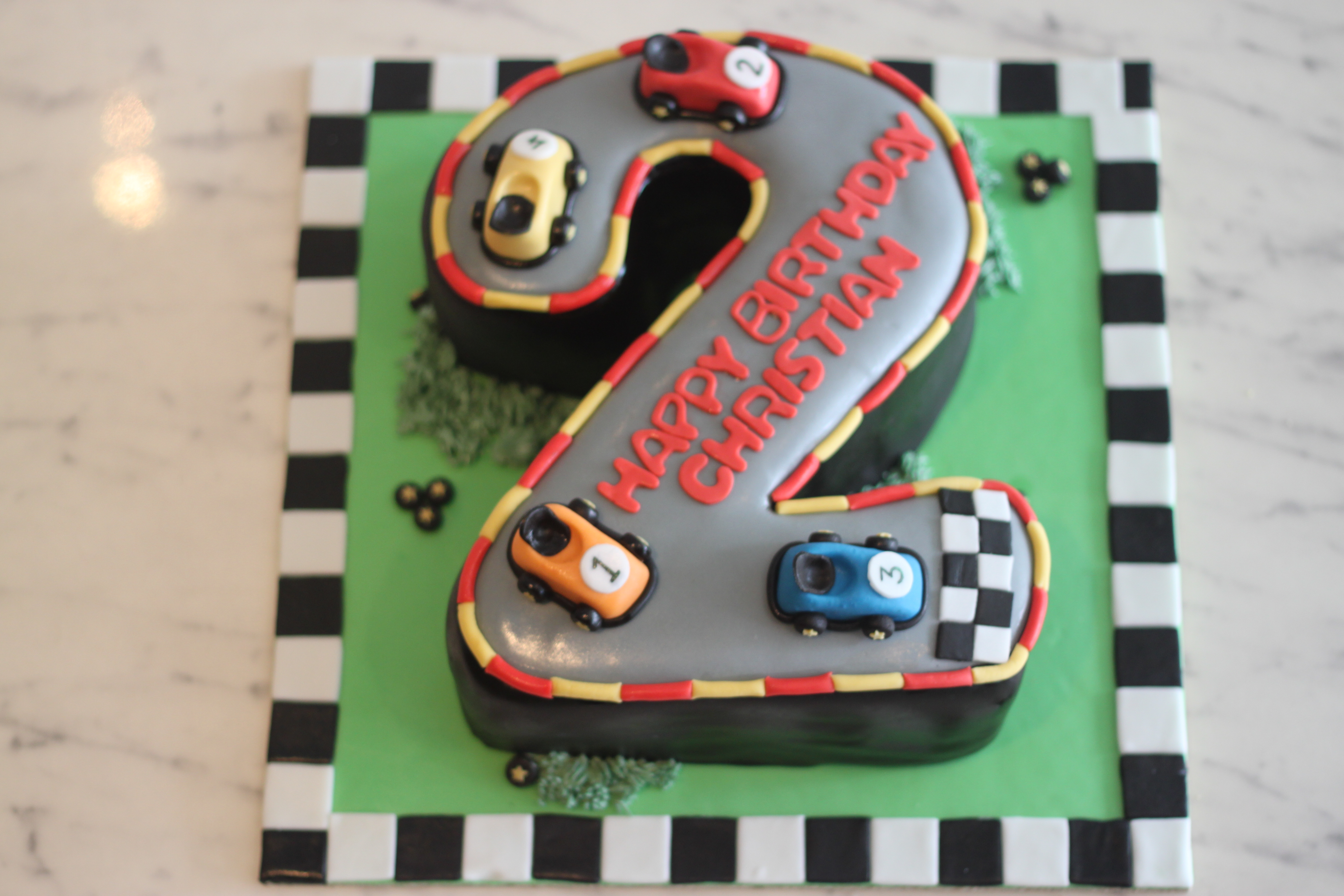 Number 2 Shaped Cakes http://muffinsareuglycupcakes.wordpress.com/2011/01/09/no-2-race-car-cake/